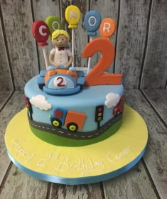 boy in car birthday cake