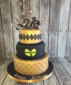 gold & black birthday cake with wootang clan