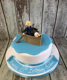 man in a boat & sheep birthday cake