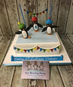 penguin ice scating birthday cake