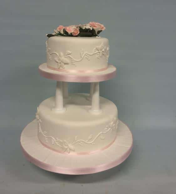 2 tier wedding cake with pillars wedding cakes amazing cakes wedding cakes based in 10185